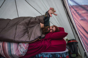 Camp bed - Man in Tent
