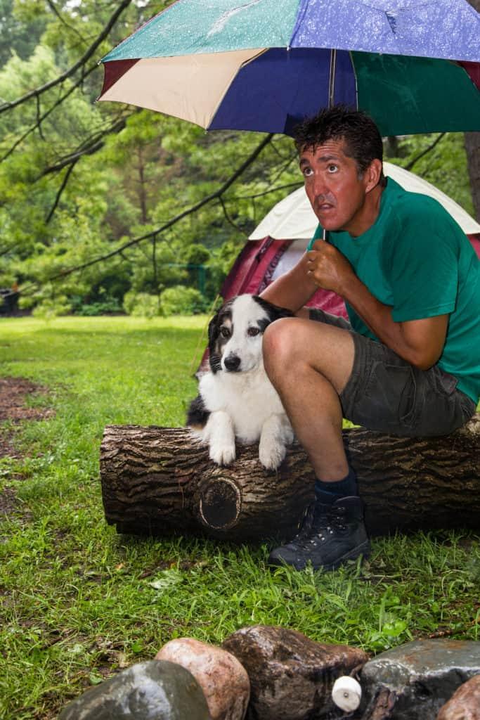 Camper huddles in the rain